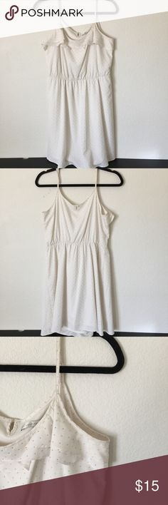 """LC Lauren Conrad studded dress This item is used. Good condition but some of the gold paint of the studs have rubbed off by the under arm area and straps. White/gold. Lined. 100% polyester. Adjustable straps. Elastic waist. Approx 36.5"""" L, 17.5"""" pit to pit, 14"""" w. LC Lauren Conrad Dresses"""