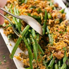 Green beans and mushrooms cooked in ranch butter and topped with french fried onions and bacon - SO much better than green bean casserole!