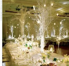 Twig centerpieces with lighted bases.