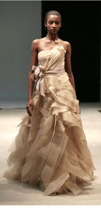 Vera Wang.  Would be a gorgeous wedding dress.