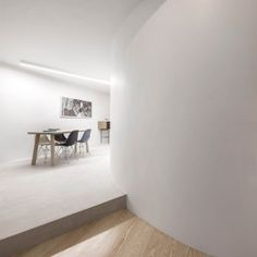 Fala+Atelier+uses+curving+wall+to+shape+open-plan+interior+for+historic+Lisbon+flat