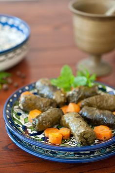 Syrian stuffed grape leaves.  Very different recipe than they way my mother taught me. Interesting using the carrots to line the bottom of the pan. I may have to try that! It's cheaper than using the leaves if you don't have access to fresh ones and have to buy them jarred. Fish Recipes, Asian Recipes, Healthy Recipes, Ethnic Recipes, Grape Leaves Recipe, Turkish Recipes, Ukrainian Recipes, Stuffed Grape Leaves, Eastern Cuisine