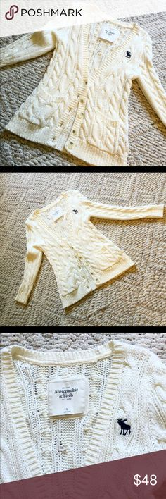 Abercrombie & Fitch cream/ivory knit cardigan Abercrombie & Fitch // cream/ Ivory button down cardigan // size small // only wore 1 time // v-cut neck /// 5 buttons /// great condition /// Abercrombie & Fitch Sweaters Cardigans
