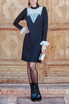 The SUAVE is a black long sleeve dress enhanced with white geometric patterns in contrasting tulle with a top stitched ribbon around the neckline and matching removable cuffs. Dress Up, High Neck Dress, Black Long Sleeve Dress, Weekend Wear, Geometric Patterns, White Shirts, Designer Dresses, Cuffs, Cold Shoulder Dress