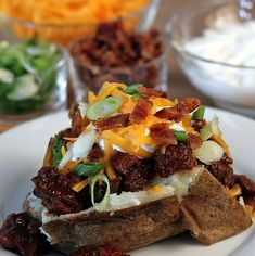 Baked Potato Bar --Toppings ideas are limitless! Baked Potato Bar, Good Food, Yummy Food, Delicious Recipes, Food For A Crowd, Big Crowd, Christmas Buffet, Christmas Foods, Christmas 2015