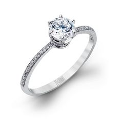 This simply elegant engagement ring from our Classic Beauty collection holds .10ctw of white diamonds in a pristine and Classic Beauty 14K white gold setting.