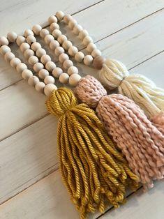 Items similar to Mustard Boho Wood Bead Tassel on Etsy Yarn Crafts, Bead Crafts, Diy Crafts, Wood Bead Garland, Beaded Garland, Garlands, Wall Collage Decor, Wall Decor, Decorated Jars