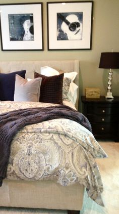 Make this bedroom male friendly by adding dark solid color accessories to counteract the feminine paisley comforter. | Houston TX | Gallery Furniture |