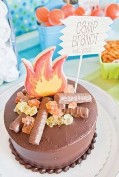 "Campfire Cake using candy bar ""logs"", rock candy ""embers"" & a roaring ""flame"" made out of a sugar cookie!"