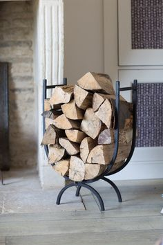 This high sided wrought iron Log Holder is a great addition to your fireplace