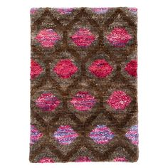 We're continually building on our rug legacy, experimenting with new colors, materials, and weaving techniques. Case in point: this bohemian beauty. Painstakingly knotted by hand in jute and viscose in a bold abstract pattern, this rug is amazingly soft and plush underfoot. Note: actual Sari ribbons are also used in the construction, an homage to the textile traditions of India, one of those little extra details we love.