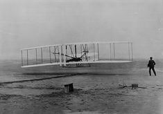 Orville Wright's famous first airplane flight.  Kitty Hawk, NC (North Carolina), December 17, 1903.