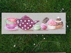 Tableau representant thé gourmand avec des macarons, une religieuse et cupcake