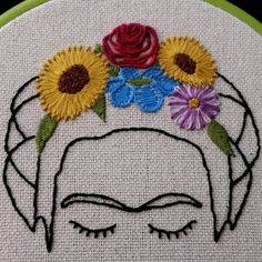A beautiful 6 embroidered hoop art featuring Frida Kahlo and one of her signature floral headdresses. Lovingly crafted by hand, each piece is unique and would be a charming gift or decor. Wood framed, felt backed, and ready for hanging or shelf display. Just add it to your cart