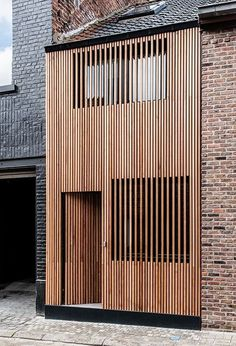 Vertical wooden slats in front of windows. town house   Ninove, Belgium   Sito Architecten