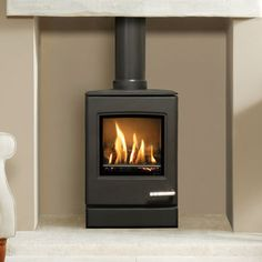 The small Yeoman Balanced flue Gas stove offers a generous heat output and features a realistic log fuel effect bed Small Gas Fireplace, Freestanding Fireplace, Stove Fireplace, Fireplace Ideas, Gas Log Burner, Wood Burner, Flueless Gas Stove, Gas Stove Parts, Wood Burning Logs