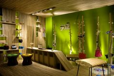 23 Wonderful Green Interior Design Ideas  This beautiful green interior design presents a nature-inspired concept with a touch of art. The designer used wood for more than 90% percent of the design, a sustainable and renewable material. The result reflects a cozy aesthetics in order to make the customers feel comfortable.