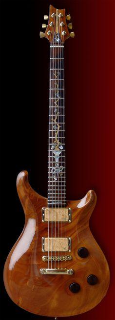 Custom electric guitar handmade PRS style cuban swietenia mahogany cocobolo knobs maple covers pickups abalone inlay on cocobolo fretboard.