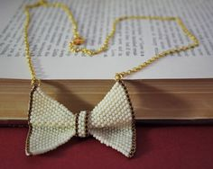 Hand-Beaded Bow Necklace on Gold Chain Bowtie by BefittingBeads