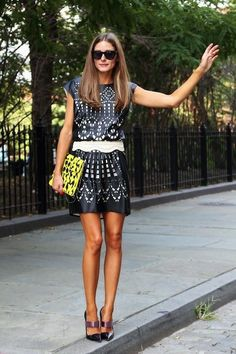 Olivia Palermo in a laser-cut leather mini dress and bright clutch. We also love her straight hair!