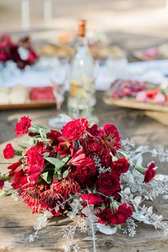 bridal bouquet red carnations, red mums, silver sprayed eucalyptus flowers designed by Social Planner Events