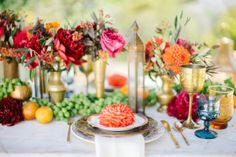 Inspired by the beauty of Morocco, Modern Dame set out to recreate that lavish, cozy vibe for a backyard luncheon with friends. With loads of pillows, lanterns and a wedding blanket under foot, the scene was set for a feast crafted by Haute Chefs