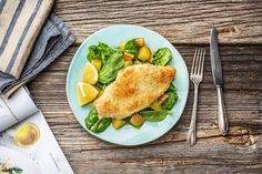Panko Parm Poulet with Potatoes over Baby Spinach in a Creamy Lemon Dressing