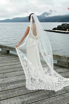 The lace trimmed veil coming from the hair adds a fantastic layer to the simplicity of an understated wedding dress V Neck Wedding Dress, Gorgeous Wedding Dress, Wedding Dress Shopping, Wedding Dress Styles, Elegant Wedding, Dream Wedding, Bridal Hair Accessories, Bride, Wedding Ideas
