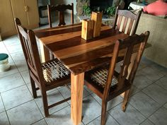 Oak and Kiaat 4 seater dining room table with 2 Meranti and 2 Oregan Pine riempie chairs.