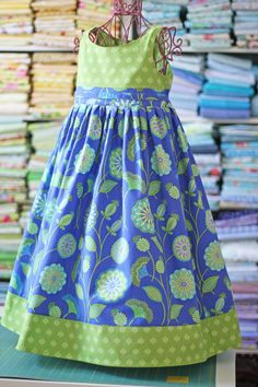 Beautiful little dress to sew...gotta make some of these for the granddaughters.... Don't have them yet but . . .