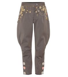 Dolce & Gabbana - Embellished cotton trousers - Dolce & Gabbana offer an opulent summertime design with this pair of cotton trousers, finished in a jodhpur-silhouette. The khaki-hued style comes with flower-shape crystal embellishments at the sides, while decorous golden chains adorn the waistline. Team yours with a black silk top. seen @ www.mytheresa.com