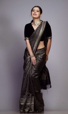 In a elegant black color saree with silver color border, elbow length sleeve blouse design and necklace Black Blouse Designs, Saree Blouse Neck Designs, Blouse Patterns, Black Saree Blouse, White Saree, Skirt Patterns, Sexy Blouse, Coat Patterns, Sewing Patterns