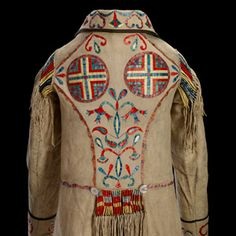 Cree Métis Coat c. 1874; Red River; Hide, mother of pearl buttons, silk ribbon, porcupine quill, dyes; metis clothing