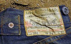 "This pair of 1890′s Levi 201′s were found in the Mojave Desert, CA. The condition of the denim was extraordinary. ""They are covered in candlewax from candles the miners used to light the tunnels. They were found in an old paper bag with the name of a mercantile store, which operated between 1895 and 1898, in the town of Randsburg, along with a gunny sack with the initials ""AP"" and ""Randsburg"" marked on it.  APK is through to be Adam P. Kuffel, a partner in the mercantile store."