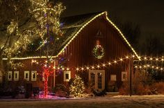 At the Denver Botanical Gardens Trail of Lights, the red barn on the property is all decked out for the holiday! Ain't she pretty? Christmas Tree Farm, Christmas Scenes, Primitive Christmas, Christmas Love, Country Christmas, Outdoor Christmas, Beautiful Christmas, Merry Christmas, Christmas Houses
