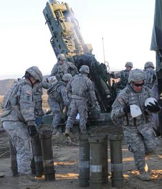 Soldiers from 2nd Battalion, 8th Field Artillery Regiment conduct a live fire of the 155m howitzer cannon during a field training excercise at Yukon Training Area in Alaska, Oct. 16, 2010. (U.S. Army photo by: Spc. Michael Blalock, 1-25th SBCT PAO.)