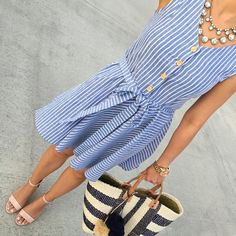 Nude heels, blue and white striped dress.