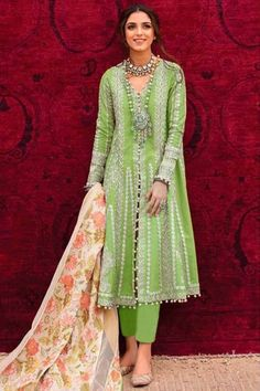 Be the cynosure of all eyes by wearing this bright green cotton trouser suit which exudes feminine charm. This v neck and full sleeve clothe designed using thread work. Accompanied by a matching santoon cigarette pant in bright green color and off white net dupatta. Cigarette pant is plain. #trousersuit #salwarkameez #malaysia #Indianwear #Indiandresses #andaazfashion
