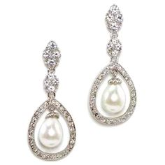 """An encased row of Swarovski crystals provides the perfect frame for this freshwater pearl drop. The earrings are great worn on their own, but they also pair effortlessly with many necklaces and headpieces. Findings are brass plated with 20mls of white gold plating, sterling silver post. * Length 1.5"""" * Width .5"""" * This item ships within 5-7 Business Days.Please allow additional time for time in transit.  Price $68.00"""
