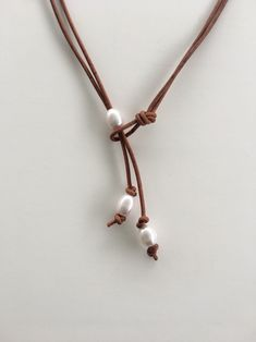 Excited to share this item from my shop: White Pearl and Natural Brown Leather Lariat Necklace Leather Pearl Necklace, Lariat Necklace, Leather Jewelry, Leather Cord, Diy Jewelry, Jewelry Making, Pearl Jewelry, Necklace Tutorial, Handmade Necklaces