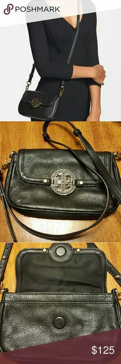 "Tory Burch Black Mini Amanda Leather Crossbody Brand New without Tag-Made for on-the-go wear but not too miniature, the Tory Burch Amanda mini messenger bag sits flush at your side and boasts three interior card slots to eliminate extra baggage. Pebbled leather. Golden hardware includes signature Tory Burch double-T medallion at center. Removable crossbody strap; 21"" drop. Front flap with hidden magnetic closure. Inside, three leather card slots; tonal nylon lining. 5 1/2""H x 8 1/2""W x 1""D…"