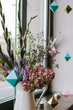 Unique DIY idea alert! Absolutely love the colourful geometric origami hanging decor at this wedding!