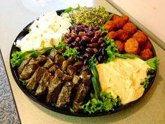 Hummus, stuffed grape leaves, tabouli, feta cheese, kalamata olives ...