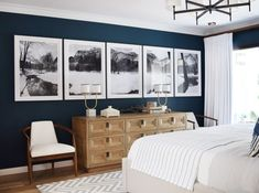 neutral bedroom design, modern bedroom design with large black and white artwork, white bedding and modern chandelier with navy wall in bedroom decor Home Decor Bedroom, Interior Design, House Interior, Master Bedroom Color Schemes, Bedroom Decor, Home, Master Bedroom Colors, Home Decor, Bedroom Wall
