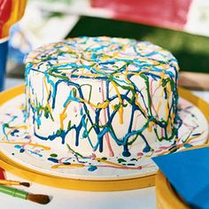 This cool Modern Art Cake can be dessert and a party activity. Each child gets a color and a turn to squiggle their artistic contribution.