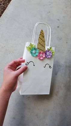 These bags are available in any combination of colors, just send me a message! : ) The paper flowers are completely handmade and hot glued to the bag and can be made using any color paper. The golden horn is also handmade from my own pattern and has gold puffy paint detail to