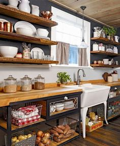 Freestanding sink and open shelving define this farmhouse kitchen.