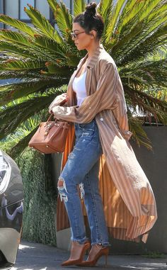 Kourtney Kardashian from The Big Picture: Today's Hot Photos  The reality star looks casual cool in her Raquel Allegra trench robe as she leaves a studio in Culver City, California.
