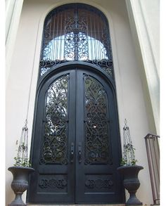 beauriful wrought iron double door with high transom burnt copper faux finish and clear glass iron front doorfront