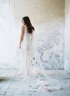 Claire Pettibone Gypsy Rose Couture Wedding Gown and floral bridal cape.